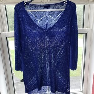 Blue sweater with sequins throughout